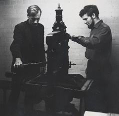 Andrew Gurr (left) using double demy Albion hand press, ca. 1962. Leeds University Library, MS 20c Northern House/3/6.